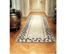 The rug in the hallway incorporated the patterns on those in the living and dining areas. Its blended design makes it a statement piece. It is important to ensure that the design in linking areas such as hallways keep to theme of the actual rooms so cohesion is achieved.